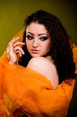 image of yashmak  - Beautiful young woman in color Arabian clothes - JPG