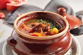 Traditional tasty hungarian goulash soup of beef meat and vegetables close up. Delicious meat stew o poster