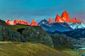 The grand crimson dawn over the mountain range Fitzroy. Mountain peak in Patagonia in the border are poster