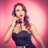 Pin up girl on a vintage telephone.  Great for all sorts of advertising where communication is vital poster