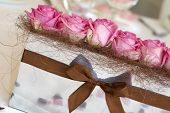 Pink Roses On The Wedding Table