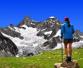 girl looking at the beautiful Mount Gabelhorn in the Swiss Alps