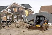 LAVALLETTE, NJ - JAN 13: A bulldozer in front of destroyed homes on January 13, 2013 in Lavallette,