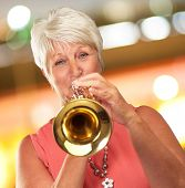Mature Woman Blowing Her Trumpet, Indoor