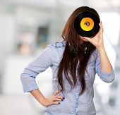Young Girl Looking At Vinyl, Outdoor