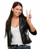 Pretty Young Woman Giving Victory Sign Over A White Background