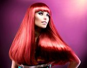 Hair. Healthy Straight Long Red Hair. Fashion Beauty Model over Purple Background. Vogue Style. Beau
