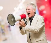 Mature Man With Megaphone, indoor