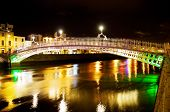 Ha'Penny Bridge Over Colorful Waters At Night In Dublin