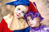 Cute portrait of two adorable little girls in clown disguise