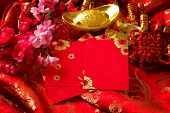 Chinese new year festival decorations , the chinese character on the gold ingots means fortune and l