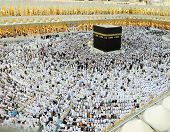 MAKKAH - JULY 21 : A crowd of pilgrims circumabulate (tawaf) Kaaba on July 21, 2012 in Makkah, Saudi Arabia. Pilgrims circumambulate the Kaaba seven times in counterclockwise direction.