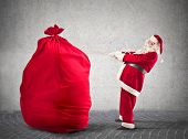 Santa Claus pulls big red sack