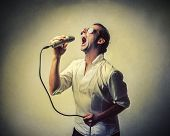 ironic singer singing to the microphone