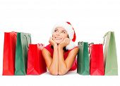 shopping, sale, gifts, christmas, x-mas concept - smiling woman in red shirt and santa helper hat wi