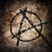 image of anarchists  - anarchy symbol on an old grunge wall background - JPG