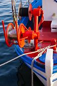 Fishing boat, detail with red colorful machinery