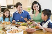 stock photo of mexican food  - Children Dinner Eating Family Lunch Parents 10 Year Old 30s 6 Year Old Boy Brother Color Colour Daughter Dining Room Domestic Elementary Age Father Food Four People Girl Happy Hispanic Home Horizontal Image Indoors Mexican Food Man Mid Adult Mother Pre - JPG