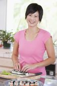 Woman Preparing Sushi