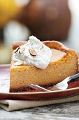 stock photo of cheesecake  - A slice of Pumpkin Cheesecake Pie with homemade whipped cream alomonds and pumpkin spice - JPG