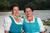 Two happy Bavarian ladies in dirndls