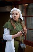 Medieval style girl at the street of  tallinn