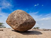 Krishna's butterball -  balancing giant natural rock stone. Mahabalipuram, Tamil Nadu, India