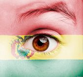 portrait of girl with bolivian flag painted on her face