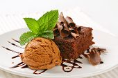 dark chocolate cake with scoop of ice cream