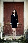 foto of manor  - Beautiful young lady in black dress at old manor - JPG