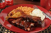 stock photo of baby back ribs  - Barbecued baby back ribs and chicken with coleslaw and baked beans - JPG