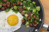 egg sunny side up with brussels and sausage