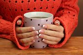 foto of hot-weather  - hands holding mug of hot drink - JPG