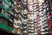 image of overpopulation  - Overpopulated residential building in Hong Kong - JPG