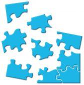 Blue Puzzle Pieces Over White
