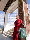 Thimpu, Bhutan - October 20, 2010: Monk Leaning On A Trash Bin On Oct. 20, 2010 Near Thimpu