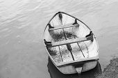 stock photo of forlorn  - black and white photo of a forlorn boat - JPG