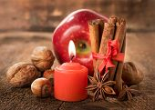 Apple With Nuts, Star Anise , Cinnamon And A Candle