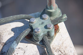 image of lightning-rod  - Intersection point Junction of Lightning rod on cement roof  - JPG