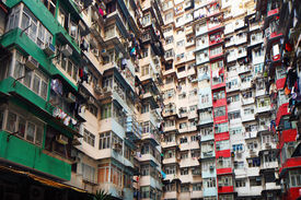 stock photo of overpopulation  - Overpopulated residential building in Hong Kong - JPG