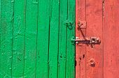 Red And Green Painted Wooden Door With Bolt