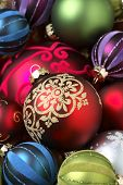 Christmas ornaments in various colors filling up frame