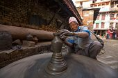 BHAKTAPUR, NEPAL - DEC 7, 2013: Unidentified Nepalese man working in the his pottery workshop. More