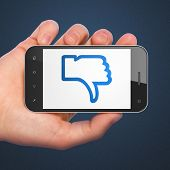 Social network concept: Thumb Down on smartphone