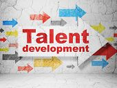 Education concept: arrow with Talent Development on grunge wall background