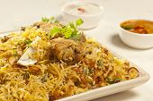 picture of raita  - Front Close up View of  Hot delicious chicken biryani.