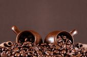 Background of coffee beans with cup