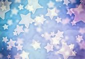 Abstract background image of blue stars lights and beams