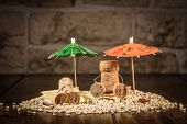 foto of midget  - Concept Holiday on a Beach with wine cork figures - JPG