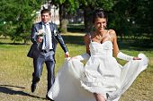 Groom Catches Bride At A Wedding Walk